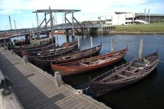 Smaller viking ships moored at the viking ship harbour in Roskilde, Denmark