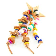 This bird toy is for leather lovers! A leather star, leather discs and colorful beads along with lots of knots make this toy fun for your Bird Toys, Cat Toys, Conure, Cockatiel, Parrots, Tan Leather, Knots, Lovers, Colorful
