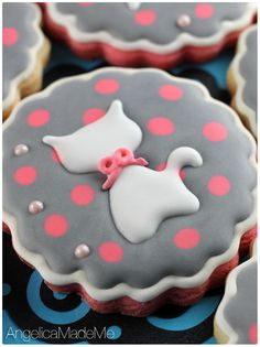 KITTEN SUGAR COOKIES. Hello, cat and cookie lovers. For variety, half the dough was tinted pink to match the pink polka dots. The decoration is all royal icing with a few mini candy pearls.