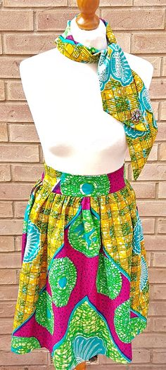 Look gorgeous in this vibrant African print high waist gathered skirt  with neck…