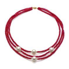 <li>Beautiful three-strand necklace boasts creamy white freshwater pearls amidst 14-karat yellow gold beads</li><li>Jewelry is laced with exquisite red coral beads</li><li>Necklace secures with a 14-karat yellow gold filigree clasp</li>