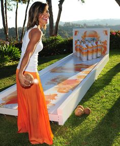 At lawn-bowling stations, guests could try to knock down prop bottles of the product. Bright, fruity images adorned the...