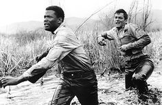 Sydney Poitier and Tony Curtis in The Defiant Ones.