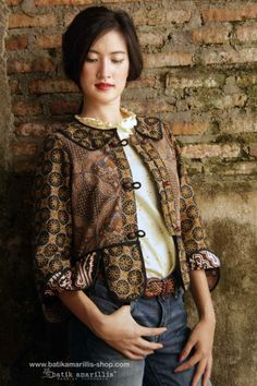 Batik Amarillis' Piccola jacket  ..Take a fresh, sweet & whimsical approach to power dressing with this Krakow-Poland classic traditional folklore inspired jacket . The beauty essential is reworked with a contrast-coloured batiks,unique cuttings ,trims,glossy beaded buttons,it has fitted waist with unique peplum petals.