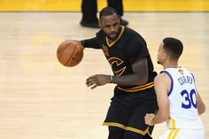 LeBron James Photos - LeBron James #23 of the Cleveland Cavaliers handles the ball against Stephen Curry #30 of the Golden State Warriors in Game 7 of the 2016 NBA Finals at ORACLE Arena on June 19, 2016 in Oakland, California. NOTE TO USER: User expressly acknowledges and agrees that, by downloading and or using this photograph, User is consenting to the terms and conditions of the Getty Images License Agreement. - 2016 NBA Finals - Game Seven