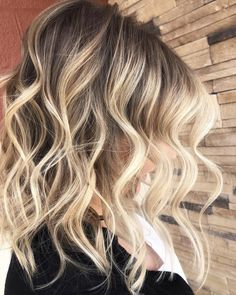 Beautiful ashy balayage with the perfect smudge root fading into bright, buttery blonde tones. In love with the beach waves, too.