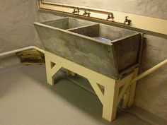 I had a three-basin soapstone sink in my 1912 basement, on a rusted-out stand. When I refurbished my laundry room, I puzzled long about what...