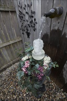 The homemade wine bottle water fountain. The homemade wine bottle water fountain. Wine Bottle Fountain, Diy Water Fountain, Garden Water Fountains, Waterfall Fountain, Fountain Ideas, Water Gardens, Outdoor Fountains, Diy Water Feature, Backyard Water Feature