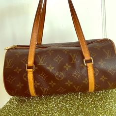 Louis Vuitton Papillon 26 Louis Vuitton Papillon 26 Size (aprx.) = W 10.24 x H 5.12 x D 5.12 inch / W 260 x H 130 x D 130 mm (Exclude handle/s or strap/s) Strap/s drop 5.12 inch / 130 mm Material = Monogram PVC / Tan leather Condition = used with natural darkening on straps. Some luster on hardwear missing. Louis Vuitton Bags Mini Bags