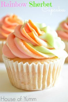These Rainbow Sherbet Cupcakes are made with real rainbow sherbet in the cake batter and topped with three flavors of swirled frosting! #houseofyumm