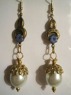Long and elegant drop earrings with Art Nouveau design pendants and large white glass pearls with ornate beadcaps. The total length from the