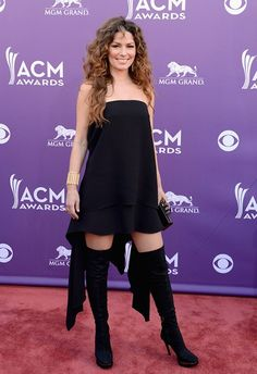 """2013 Academy of Country Music Awards Red Carpet Country musics hottest stars hit the red carpet at the 2013 Academy of Country Music Awards in Las Vegas. Wowza! Shania Twain, 47, doesn't look a day over 40 in her black mini dress, thigh-high black boots, and wild tresses. We're not in love with the """"Come on Over"""" diva's look, but we have to admit, she's smokin' hot."""