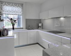 High-gloss Magnolia and Wild Oak kitchen - Ex Display Kitchens from in-toto kitchens Halifax