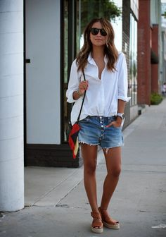 Julie Sarinana Is Wearing A White Boyfriend Shirt From Silence & Noise, Denim Shorts From Levi's, Espradilles From Vince, Bag From Proenza S...