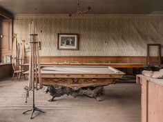 Striking Image of an Abandoned Billiard Table in a Derelict Mansion