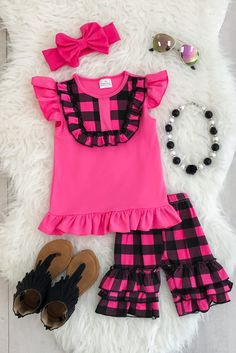 Holli Hot Pink Ruffle Short Set from Sparkle in Pink This outfit is absolutely adorable and so on point with trends! Hot pink and black plaid paired with cotton matching ruffle shorts! Little girls love this! Perfect for Summer! This outfit is sure to turn heads and has a high designer look, without the designer price! This is a must have for your little fashionistas closet! Super stylish, yet so comfy for everyday wear!