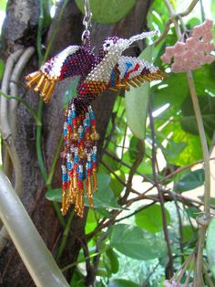Hey, I found this really awesome Etsy listing at https://www.etsy.com/listing/234394674/hummingbird-beaded-3d-bird-ornament-seed