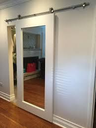 Image result for sliding barn door with mirror