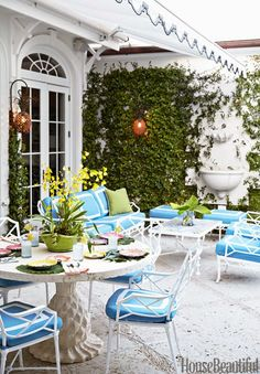 The designers had the cast-coquina dining table made for the terrace and circled it with Brown Jordan Calcutta II chairs, the same collection used for the seating area. Cushions are in Sunbrella's Spectrum Sailor.