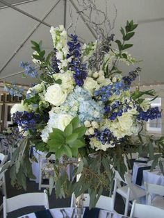Beautiful Centerpiece: White Hydrangea, White Roses, White Spray Roses, White Snapdragons, Blue Hydrangea, Blue Delphinium, Several Varieties Of Greenery & Foliage Including Eucalyptus