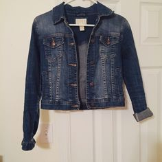 Mini Jean Jacket 100% jeans slightly distressed jacket. Cuts off at the waist. Sleeves can be rolled or unrolled. Very cute over blouses, tanks, and dresses  Forever 21 Jackets & Coats Jean Jackets
