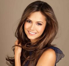 Nina Dobrev - beautiful makeup for brunettes.  Final touch?  A great smile.
