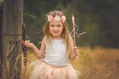 Summer style for this sweet girl. Floral headband, swirly wand and tulle skirt. Children photography. Natural light. Fine Art children photography. Melbourne Family Photography