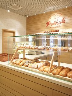 "Bakery ""Prökuls"" (german for ""Priekulė"") fosters long-lasting German traditions of pastry and confectionary. Bakery Shop Interior, Bakery Shop Design, Cafe Interior Design, Coffee Shop Design, Restaurant Design, Plywood Furniture, Design Furniture, Plywood Floors, Kid Furniture"
