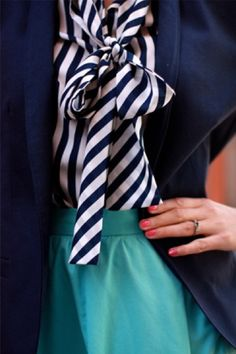 Needed a new look for my green work skirt. Like this nautical inspired spin. Navy and white striped tie neck blouse with navy blazer.