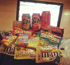 <3 box of yummy snacks - creme eggs, skittles, nerds, cans of drpepper, fantas, oreos, bags of snackojack crisps
