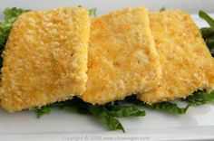 Crispy Baked Tofu Makes 10 to 12 slices  1 pound firm or extra firm tofu, drained and water pressed out 1 cup panko breadcrumbs 1 tablespoon nutritional yeast 1/2 teaspoon onion powder 1/2 teaspoon garlic powder 1/4 teaspoon salt Olive oil