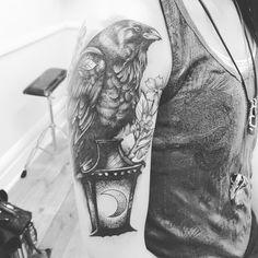 Arm tattoo raven lantern moon black and grey