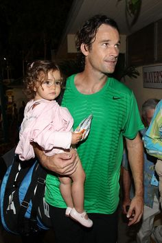 Carlos Moya and his cute daughter, Carla, in Delray after he won the Champs final last night