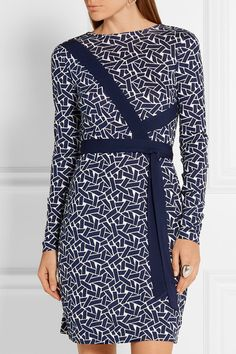 Diane von Furstenberg's 'Vienna' dress is cut from fluid silk-jersey that drapes beautifully. Printed with the label's geometric 'ribbon weave' motif, this reversible style has a flattering wrap silhouette - an iconic brand signature. Pair yours with flats or heels depending on the occasion.