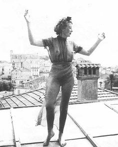 * Eileen Agar dancing on a roof outside Mougins in 1937. British surrealist artist who was close friends with Lee Miller's partner, Roland Penrose. Penrose had included her work in the 1936 'International Surrealist Exhibition' in London. The following year Miller took several photographs of Agar, of which this is one.