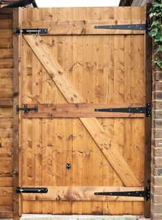 Learn how to build a decorative cedar wooden gate for your yard with this tutorial that will help increase your home's property value and security. Wood fences Wood-fences Garden fences Cheap fence ideas Garden design Gardening Horizontal fence City gardens Garden ideas Cottage gardens Landscape design Small gardens Modern garden design Modern gardens Small garden design Water features Wooden Gate Door, Building A Wooden Gate, Wooden Garden Gate, Backyard Gates, Garden Gates And Fencing, Fence Gate Design, Privacy Fence Designs, Diy Gate, Diy Fence