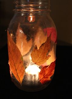 Leaf Lantern. Gather leaves with your child and use modge podge to attach them to a mason jar. Put a tea light inside.