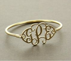 Cut Out Monogram Bracelet Gold Tone. if that had a J on it I would buy it hahahaha, wait! where do I get one of those things?