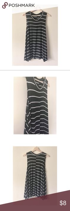Stripe Swing Tunic Flowy stripe swing tunic. Great length for leggings. Could even be worn as a maternity top! Lots of extra flowy fabric! Arm hole are a little longer and meant to show a cute bralette.   Please don't ask me to try on clothes, prices reflect the inconvenience. NO TRADES! Thank you! Tops Tank Tops
