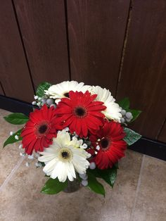 Alabama bridal bouquet with red and white gerbera daisies, baby's breath, brunia, and greens #rolltide by #SunshineFlorist