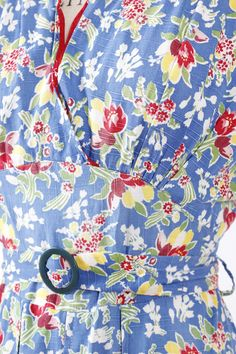 vintage 1930s day dress / house dress in a blue cotton with red and yellow floral print (detail)