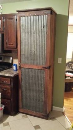 Corrugated tin and pine pantry cabinet