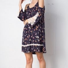 Summer sale☀️Floral chiffon cold shoulder dress Navy with floral design, open shoulder, long sleeves, and lace on sleeves. Great little details and perfect as stand alone dress or paired with leggings. Small, medium, and large available. April Spirit Dresses Mini