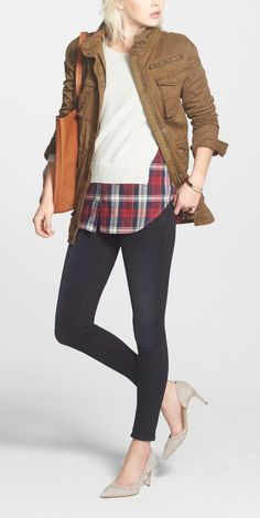This perfect weekend ensemble is pulled together by the trendy plaid layered shirttail sweater. Love it.
