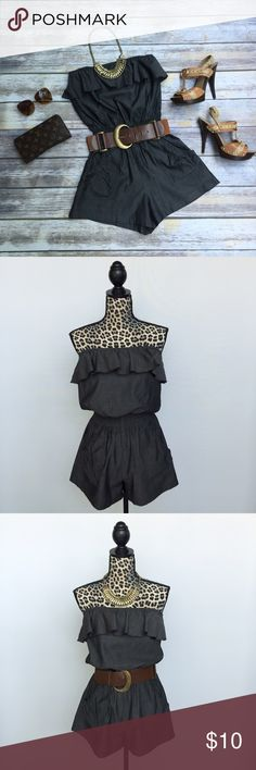 Strapless Ruffle Romper, Size Small Strapless Ruffle Romper (shorts). Brand is Poetry Clothing. Size Small. Color is a dark greyish black with a slight sheen. Elastic top with a ruffles all the way around. Elastic waist, 2 front pockets. Can be dressed up with a belt (belt not included). Pre-owned, good condition, only worn a couple times. Poetry Pants Jumpsuits & Rompers
