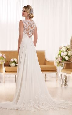 Feminine and flirty, this designer chiffon sheath beach wedding dress from the Essense of Australia bridal gown collection features pretty ruching on its fitted bodice, lace shoulder straps, and illusion lace back detailing.