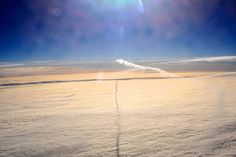 A contrail's shadow over a stratus.