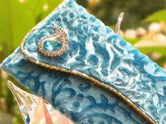 blue jewel clutch