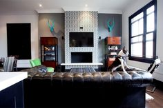 Living room in Daniel Lowe's Hollywood loft with tufted leather couch and trellis fretwork gray wallpaper on on the fireplace Fireplace Decor, Loft Living, Wallpaper Fireplace, Funky Home Decor, Home, Rustic Chic Living Room, Home Decor Styles, Rustic Industrial, Chic Living Room Design