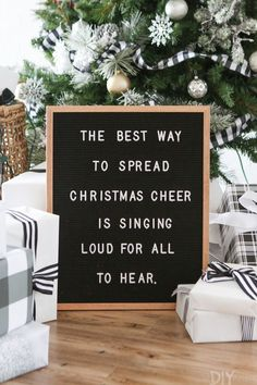 A black and white Christmas tree full of buffalo check pattern. Love this simple and elegant look for a neutral Christmas Tree. Love this letterfolk board to display a message at the bottom of the tree #ChristmasCheer #Christmastree
